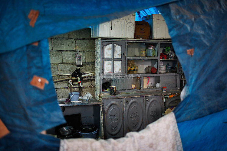 26/08/15. Shaqlawa, Iraq. -- The inside of the house of one of the 11 displaced families in Tajawaz area. 11 families live in this neighborhood, where they rent small houses from Kurdish families. Each small house comprises of a bedroom and a kitchen and cost about 350.000 IQD per month. The houses were built by the owners without authorization from the municipality and are deemed inhabitable.