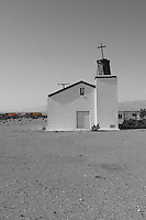Old church, Amboy, California with color train in background