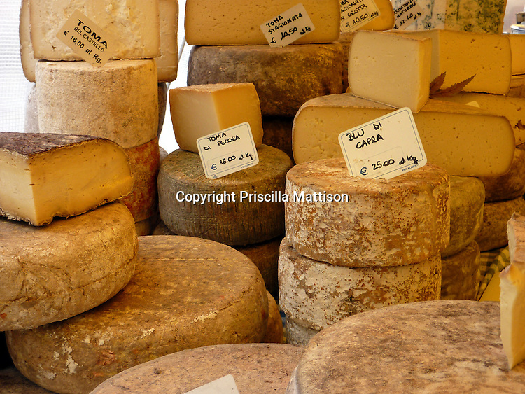 Turin, Italy - February 5, 2012:  Cheese is piled high at a cheese stand.