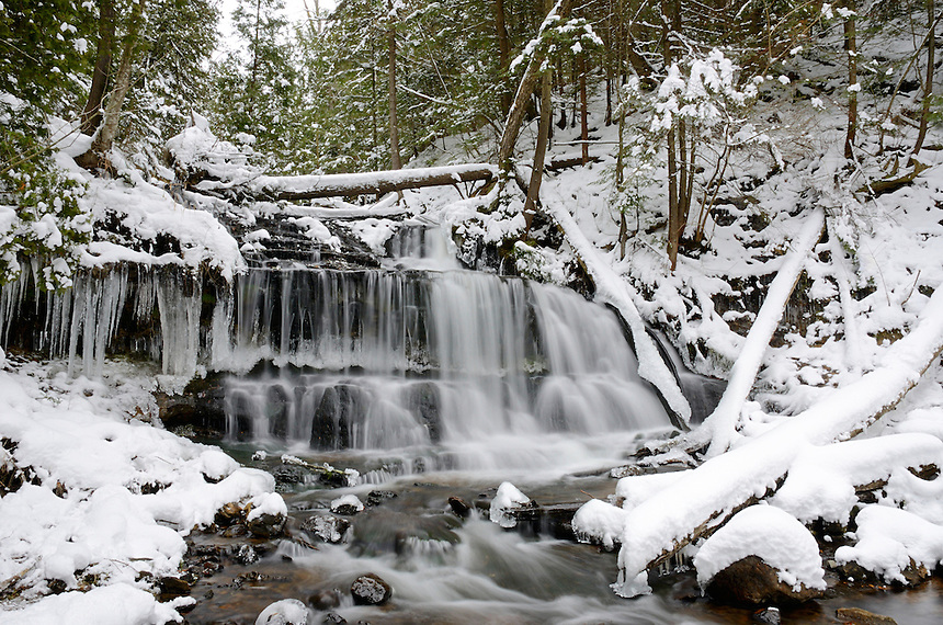 Fresh snow blankets Wagner Falls in Munising, MI