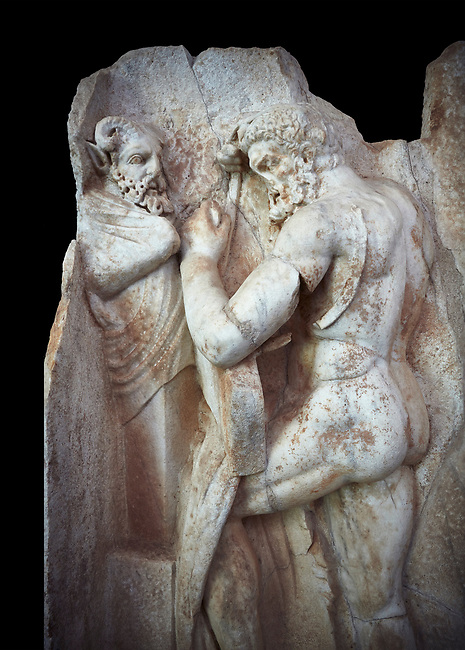Close up of a Roman Sebasteion relief sculpture of  Herakles is preparing to wrestle the Libyan giant Antaios. Aphrodisias Museum, Aphrodisias, Turkey.<br /> <br /> Herakles (left) is taking off his bow case to hang it on a pillar statue. Antaios (right) is binding up his head with ear protectors, next to him stands an oil basin used in the palaistra (wrestling ground). Antaios was a famous wrestler who challenged and killed all visitors to his country, until he was defeated by Herakles.