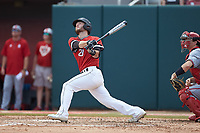 Scott Holzwasser (28) of the Northeastern Huskies follows through on his swing against the North Carolina State Wolfpack at Doak Field at Dail Park on June 2, 2018 in Raleigh, North Carolina. The Wolfpack defeated the Huskies 9-2. (Brian Westerholt/Four Seam Images)