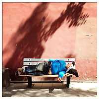 A man sleeps next to the walls of the Forbidden City in central Beijing.