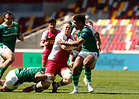 24th April 2021; Brentford Community Stadium, London, England; Gallagher Premiership Rugby, London Irish versus Harlequins; Alex Dombrandt of Harlequins tackled by Curtis Rona and Ben Loader of London Irish