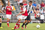 Juventus' player Paulo Dybala battles South China's player Sean Tse Ka Keung for the ball during the South China vs Juventus match of the AET International Challenge Cup on 30 July 2016 at Hong Kong Stadium, in Hong Kong, China.  Photo by Marcio Machado / Power Sport Images