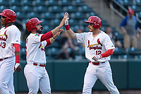 Springfield Cardinals Chris Chinea (26) congratulates Conner Capel (12) after scoring a run during a Texas League game against the Amarillo Sod Poodles on April 25, 2019 at Hammons Field in Springfield, Missouri. Springfield defeated Amarillo 8-0. (Zachary Lucy/Four Seam Images)