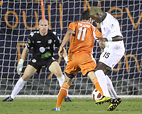 Daniel Paladini #11 Of the Carolina Railhawks tackles Sandy Gbandi #15 of the Puerto Rico Islanders during the second leg of the USSF-D2 championship match at WakeMed Soccer Park, in Cary, North Carolina on October 30 2010. The game ended 1-1, Puerto Rico won on overall goals 3-1.
