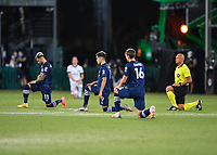 LAKE BUENA VISTA, FL - AUGUST 01: New York City FC and referee Robert Sibiga take a knee during a game between Portland Timbers and New York City FC at ESPN Wide World of Sports on August 01, 2020 in Lake Buena Vista, Florida.