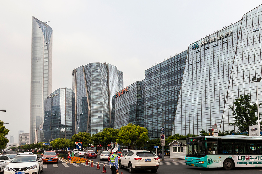 Suzhou, Jiangsu, China.  Dadaodong Street Traffic.  International Financial Center, Tallest Building in Jiangsu, on left.