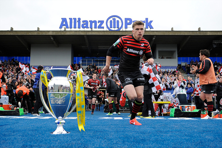 20130512 Copyright onEdition 2013©.Free for editorial use image, please credit: onEdition..Owen Farrell of Saracens runs out at the beginning of the Premiership Rugby semi final match between Saracens and Northampton Saints at Allianz Park on Sunday 12th May 2013 (Photo by Rob Munro)..For press contacts contact: Sam Feasey at brandRapport on M: +44 (0)7717 757114 E: SFeasey@brand-rapport.com..If you require a higher resolution image or you have any other onEdition photographic enquiries, please contact onEdition on 0845 900 2 900 or email info@onEdition.com.This image is copyright onEdition 2013©..This image has been supplied by onEdition and must be credited onEdition. The author is asserting his full Moral rights in relation to the publication of this image. Rights for onward transmission of any image or file is not granted or implied. Changing or deleting Copyright information is illegal as specified in the Copyright, Design and Patents Act 1988. If you are in any way unsure of your right to publish this image please contact onEdition on 0845 900 2 900 or email info@onEdition.com
