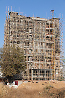 Jaipur, Rajasthan, India.  Bamboo Scaffolding on High-rise Building under Construction.