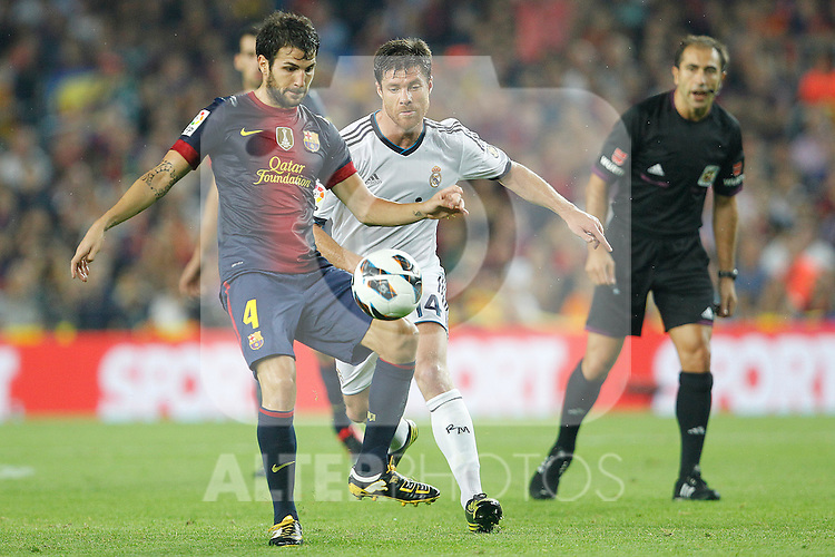 Barcelona's Cesc Fabregas and Real Madrid's Xabi Alonso during la Liga match on october 7th 2012. ..Photo: Cesar Cebola  / ALFAQUI
