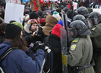 Demonstrators push on riot police officers as students protest tuition hikes Thursday, March 1, 2012 in front of the legislature in Quebec City.<br /> <br /> PHOTO :  Francis Vachon - Agence Quebec Presse