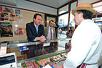 David Cameron, the Conservative Party leader with Hugh Evans the butcher in Carmarthen as he toured the area and spoke to local businesses during his visit to South Wales today..The Conservatives want to introduce a bill demanding compulsory country of origin labelling, which will require products carrying the UK flag to be born, reared and processed in Britain...