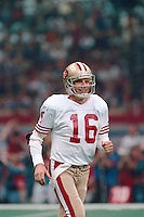 NEW ORLEANS, LA - Quarterback Joe Montana of the San Francisco 49ers smiles during Super Bowl XXIV against the Denver Broncos at the Superdome in New Orleans, Louisiana on January 28, 1990. Photo by Brad Mangin.
