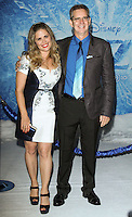 """HOLLYWOOD, CA - NOVEMBER 19: Jennifer Lee, Chris Buck at the World Premiere Of Walt Disney Animation Studios' """"Frozen"""" held at the El Capitan Theatre on November 19, 2013 in Hollywood, California. (Photo by David Acosta/Celebrity Monitor)"""
