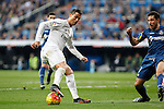 Real Madrid´s Cristiano Ronaldo (L) and Getafe´s Roberto Lago during La Liga match at Santiago Bernabeu stadium in Madrid, Spain. December 05, 2015. (ALTERPHOTOS/Victor Blanco)