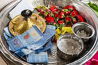 Tray with Offerings and Donations to the Hindu Sri Maha Muneswarar Temple, Kuala Lumpur, Malaysia.