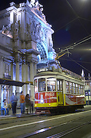Old tram. Arc de Triomphe baroque style on Praca do Comercio. Lisbon, Portugal