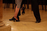 Tango dancers take part in a class at the Ideal tea house, in Buenos Aires, Argentina, April 25, 2003. Opened in 1912 the Ideal tea house remains one of the symbols of tango through the years. Photo by Quique Kierszenbaum