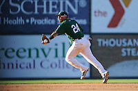 Second baseman Yoan Moncada of the Greenville Drive makes a backhand flip in a game against the Charleston RiverDogs on Sunday, June 28, 2015, at Fluor Field at the West End in Greenville, South Carolina. The Cuban-born 19-year-old Red Sox signee has been ranked the No. 1 international prospect in baseball by Baseball America. Charleston won, 12-9. (Tom Priddy/Four Seam Images)