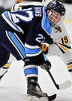 3 December 2011: University of Maine Black Bear forward Stu Higgins, a Freshman from Troy, MI, takes a face-off during game action against the University of Vermont Catamounts at Gutterson Fieldhouse in Burlington, Vermont. The Catamounts fell to the Black Bears 5-2 in the second game of their 2-game Hockey East weekend series. Mandatory Credit: Ed Wolfstein Photo