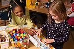 Education Elementary School Grade 1 boy and girl using math manipulatives