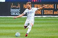CHICAGO, UNITED STATES - AUGUST 25: Caleb Stanko #33 of FC Cincinnati kicks the ball during a game between FC Cincinnati and Chicago Fire at Soldier Field on August 25, 2020 in Chicago, Illinois.