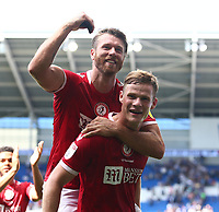 28th August 2021; Cardiff City Stadium, Cardiff, Wales;  EFL Championship football, Cardiff versus Bristol City; Rob Atkinson and Nathan Baker of Bristol City celebrate the win in front of the travelling supporters