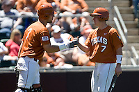 Texas Lonhorn  2B Jordan Etier is greeted by catcher Cameron Rupp after he scores against Oklahoma State on Sunday April 25th, 2010 at UFCU Dish-Falk Field in Austin, Texas.  (Photo by Andrew Woolley / Four Seam Images)