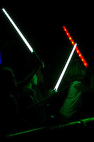 Fans light up the night with their lightsabers during the post game fireworks following the South Atlantic League game between the Delmarva Shorebirds and the Kannapolis Intimidators at Kannapolis Intimidators Stadium on June 25, 2016 in Kannapolis, North Carolina.  The Intimidators defeated the Shorebirds 2-1.  (Brian Westerholt/Four Seam Images)