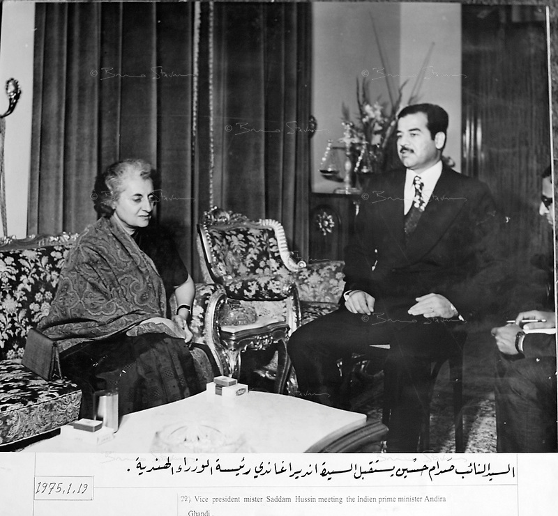 """January 19, 1975, location unknown, Saddam Hussein meets India prime minister Indira Gandhi..Photograph recovered by Bruno Stevens in the looted """"Triumphant Leader"""" museum in Baghdad, entirely dedicated to the glory of Saddam Hussein."""