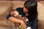 3 week old newborn baby boy with mother held listening to her talk responding