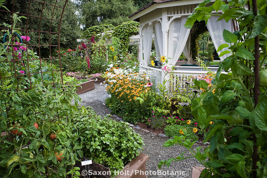 Edible landscaping garden design with gazebo and flowers surrounded by raised beds of vegetables and herbs