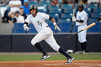 Tampa Yankees outfielder Mason Williams #14 bunts during a game against the Lakeland Flying Tigers at Steinbrenner Field on April 6, 2013 in Tampa, Florida.  Lakeland defeated Tampa 8-3.  (Mike Janes/Four Seam Images)