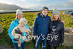 Caroline Burke with her dog standing with Catherine and Selim Gleeson from Tralee as they enjoy a stroll in Blennerville on Sunday.