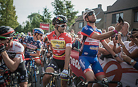 an amateur rider sneaked in on the start grid front row & did the only other thing left to do: take a selfie with World Champion Peter Sagan (SVK/Tinkoff)<br /> <br /> 12th Eneco Tour 2016 (UCI World Tour)<br /> stage 4: Aalter - St-Pieters-Leeuw (202km)