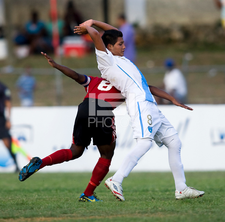 Franklin Garcia (8) of Guatemala tries to show he isn't fouling Karl Muckette (8) of Trinidad & Tobago  during the group stage of the CONCACAF Men's Under 17 Championship at Jarrett Park in Montego Bay, Jamaica. Trinidad & Tobago defeated Guatemala, 1-0.