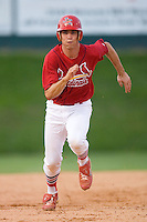 Robert Stock #35 of the Johnson City Cardinals takes off for third base at Howard Johnson Field August 1, 2009 in Johnson City, Tennessee. (Photo by Brian Westerholt / Four Seam Images)