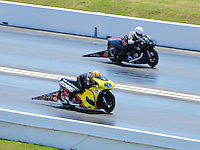 Apr. 29, 2011; Baytown, TX, USA: NHRA pro stock motorcycle rider Michael Phillips (near) races James Surber during qualifying for the Spring Nationals at Royal Purple Raceway. Mandatory Credit: Mark J. Rebilas-