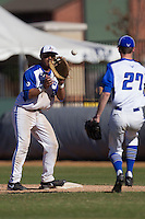 Air Force Falcons first baseman Seth Kline (35) catches a tossed ball from pitcher Nathan Stanford (27) during the NCAA season opening baseball game against the Washington Huskies on February 14, 2014 at Bobcat Ballpark in San Marcos, Texas. Air Force defeated Washington 14-9. (Andrew Woolley/Four Seam Images)