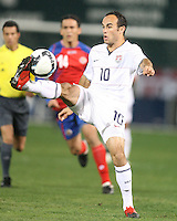 Landon Donovan #10 of the USA  hooks the ball during a 2010 World Cup qualifying match against Costa Rica in the CONCACAF region at RFK Stadium on October 14 2009, in Washington D.C.The match ended in a 2-2 tie.