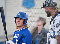 IMG Academy Ascenders Jackson Werth (16) talks with his father Jayson Werth while on deck during a game against the Montverde Academy Eagles on April 8, 2021 at IMG Academy in Bradenton, Florida.  (Mike Janes/Four Seam Images)