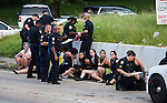BATON ROUGE, LA -JULY 10: Several arrested protesters get processed on the scene after a march on July 10, 2016 in Baton Rouge, Louisiana. Alton Sterling was shot by a police officer in front of the Triple S Food Mart in Baton Rouge on July 5th, leading the Department of Justice to open a civil rights investigation. (Photo by Mark Wallheiser/Getty Images)