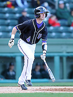 Catcher Zach Greenwell (4) of the Furman Paladins in a game against the Michigan State Spartans on February 25, 2012, at Fluor Field in Greenville, South Carolina. (Tom Priddy/Four Seam Images)