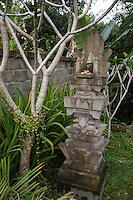 Bali, Indonesia.  Offering (Canang) in a Shrine in Honor of Family Ancestors.