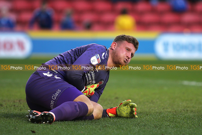 Charlton Athletic goalkeeper, Dillon Phillips lies injured on the pitch awaiting treatment during Charlton Athletic vs Barnsley, Sky Bet EFL Championship Football at The Valley on 1st February 2020