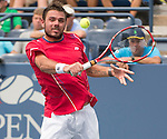 Stanislaus Wawrinka (SUI)  battles Marcos Baghdatis (CYP) at the US Open being played at USTA Billie Jean King National Tennis Center in Flushing, NY on September 1, 2013