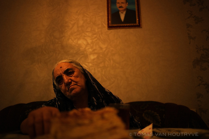 Valida, 73, a widowed refugee from Nagorno-Karabakh conflict sits in her home in Baku, Azerbaijan. Despite a massive surge of newly constructed apartments in Baku, many of the least well off residents, like refugees, continue to live in poor housing. Most of the new housing developments are focused on the rich.