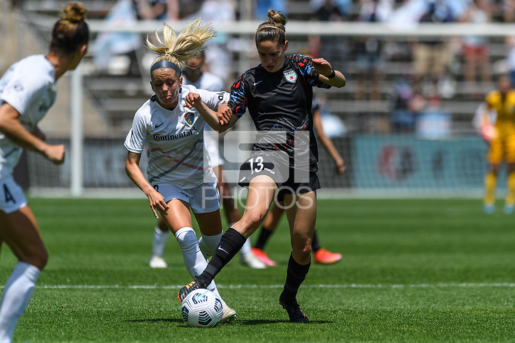 BRIDGEVIEW, IL - JUNE 5: Morgan Gautrat #13 of the Chicago Red Stars dribbles the ball as Denise O'Sullivan #8 of the North Carolina Courage defends during a game between North Carolina Courage and Chicago Red Stars at SeatGeek Stadium on June 5, 2021 in Bridgeview, Illinois.